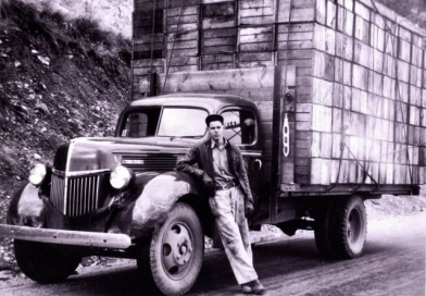 Milton poses beside 1940 two-ton Ford truck in 1945
