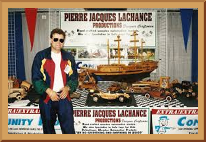 Younger Pierre Lachance Displaying His Wooden Models